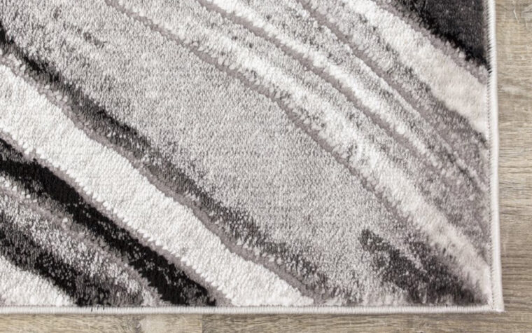 Chorus Area Rug by Kalora - black, cream, and grey marbled area rug - modern (close-up)