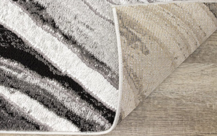 Chorus Area Rug by Kalora - black, cream, and grey marbled area rug - modern (backing)