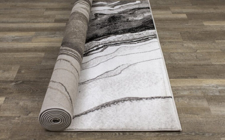 Chorus Area Rug by Kalora - black, cream, and grey marbled area rug - modern (rolled up)