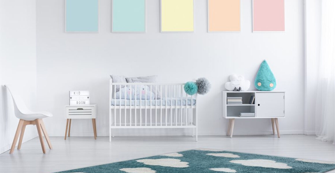 Kalora Kids Cloud 9 Area Rug - blue kids area rug with white clouds - room shot with rug on the floor of a white nursery with colourful decor