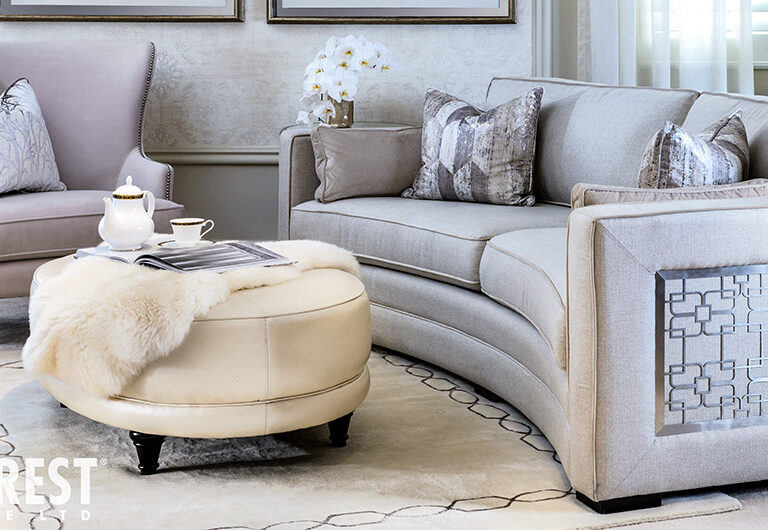 Curved sofa 9815 by Decor-Rest with silver metal accent detailing on the side/arm