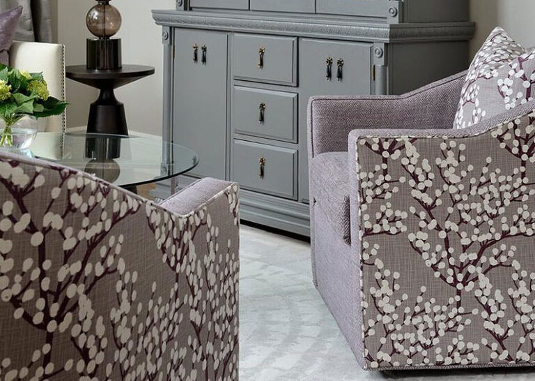 Vogel swivel chairs in mauve combination upholstery - solid mauve fabric on seat and mauve blossoming tree design on sides and back with matching throw pillow