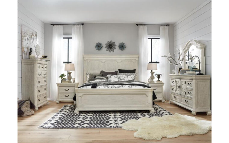 B4436 Bronwyn Bedroom Collection - Universal Furniture - Alabaster finish accented by Antique Brass hardware on full suite of bedroom furniture with traditional carvings and curved details
