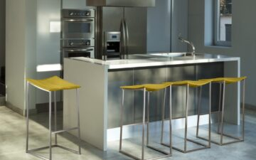 A Simple Guide to Stools - Chervin Furniture & Design - yellow Trica stools up against a white waterfall breakfast bar