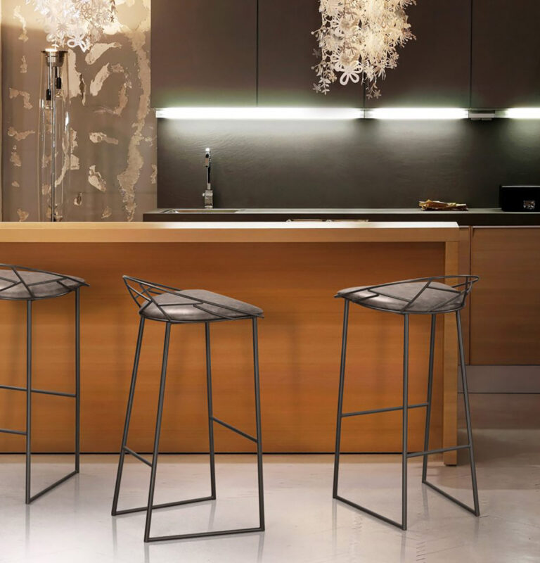 Trica barstools with minimalist back - grey and black tucked away under wooden waterfall breakfast bar in modern kitchen