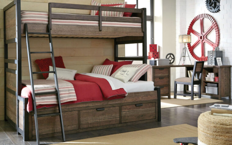 5900-6100 - Fulton County Desk - industrial kids' desk with 3 drawers (metal edge pulls) and open back; weathered brown finish; staged with matching chair in youth bedroom with Fulton County bunkbed set in foreground (red and white bedding)