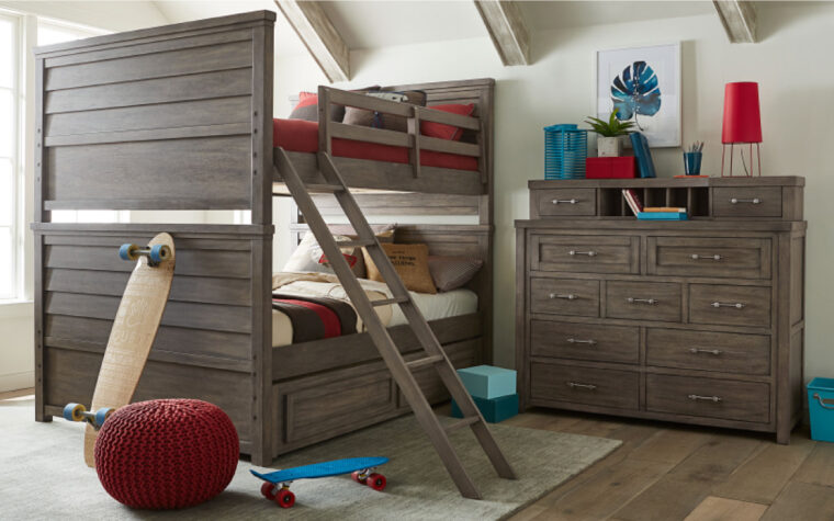 8830-1500 - Bunkhouse Bureau - 9-drawer dresser with removable hutch on top (2 more drawers and 5 mail slots); staged on wooden floor against white wall near bunk bed with ladder in kids' bedroom
