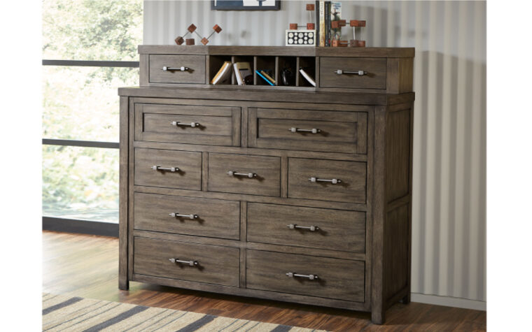 8830-1500 - Bunkhouse Bureau - 9-drawer dresser with removable hutch on top (2 more drawers and 5 mail slots); staged on wooden floor against white wall near large window in kids' bedroom