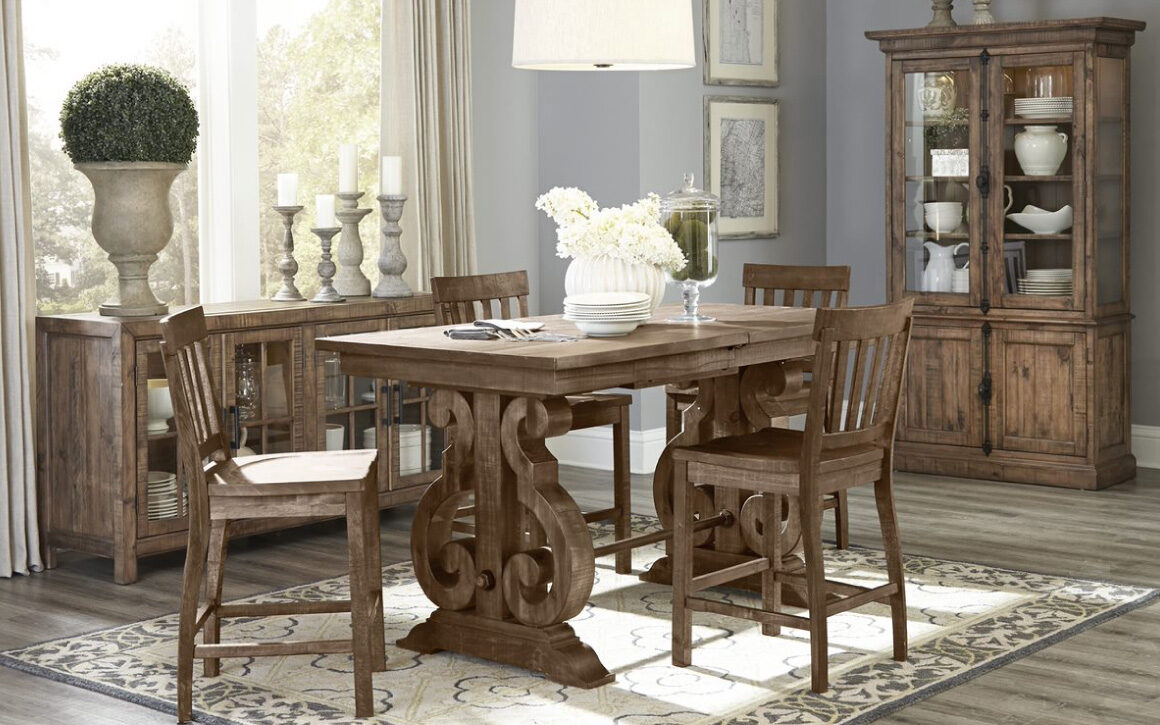 Willoughby Dining Cabinet - Magnussen - pine solids and antique brass hardware with pewter overlay; room shot with 6 wooden chairs around rectangular dining table and dining cabinet behind