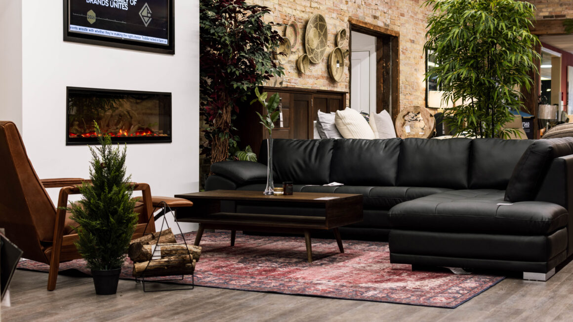 Leather furniture - Oxford & Black Sectional by fireplace on main floor of Chervin Furniture & Design in Elmira