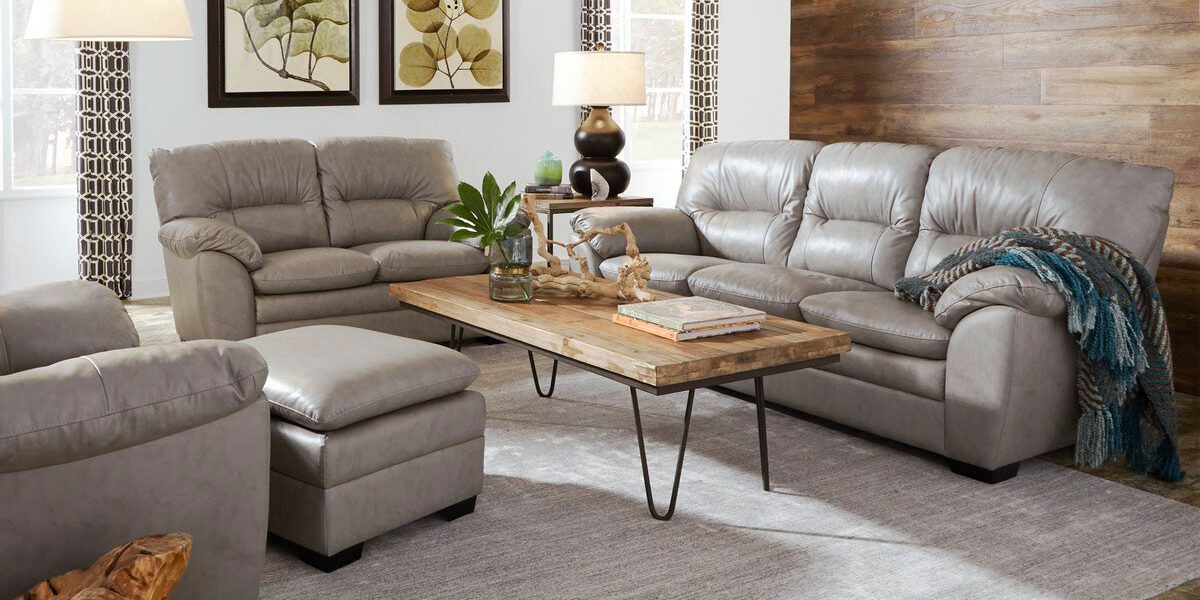 Palliser-leather sofa, chair, and loveseat - upholstered in light grey leather with wooden cocktail table (with metal legs) in between