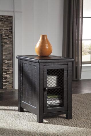 Dark wood chairside end tabe with door in living room