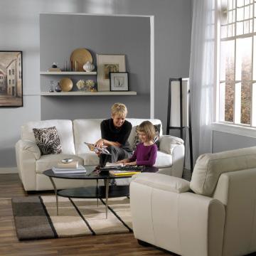 grandma and child playing on sofa