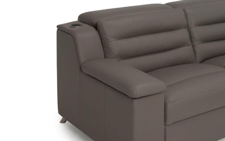 Armrest details of dark grey leather sectional