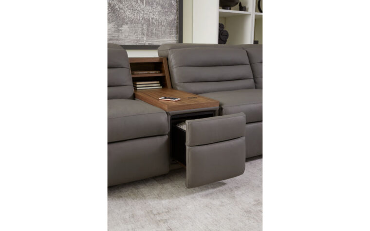 Sectional console with table top, wireless charging, and upholstered drawer. Room Image