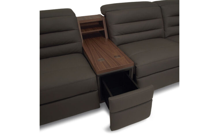 Sectional console with table top, wireless charging, and upholstered drawer. Drawer open