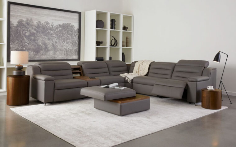 Room image of Dark grey leather sectional with tufted back cushions