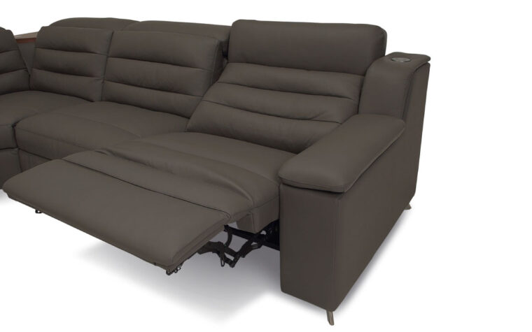 Reclinling seat of dark grey leather sectional with tufted back cushions