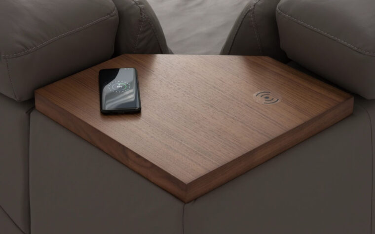 Wood table in corner of sectional by headrest with wireless charging ports