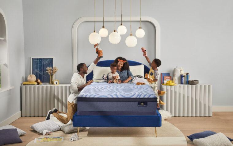 parents and children playing on serta mattress