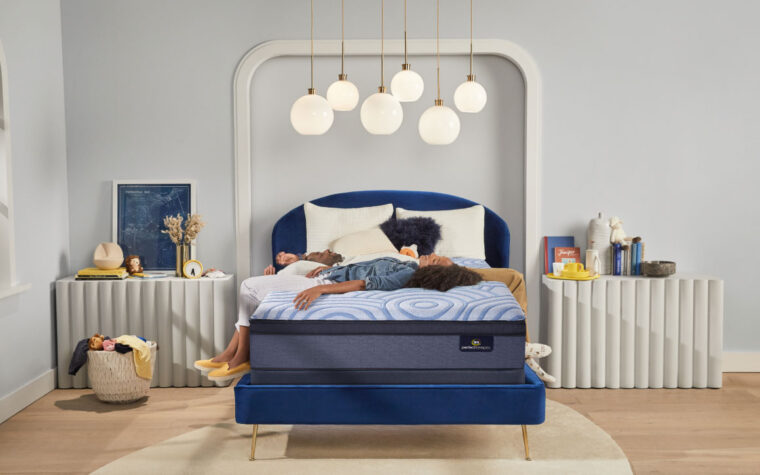 perpetual mattress with parents lying on it